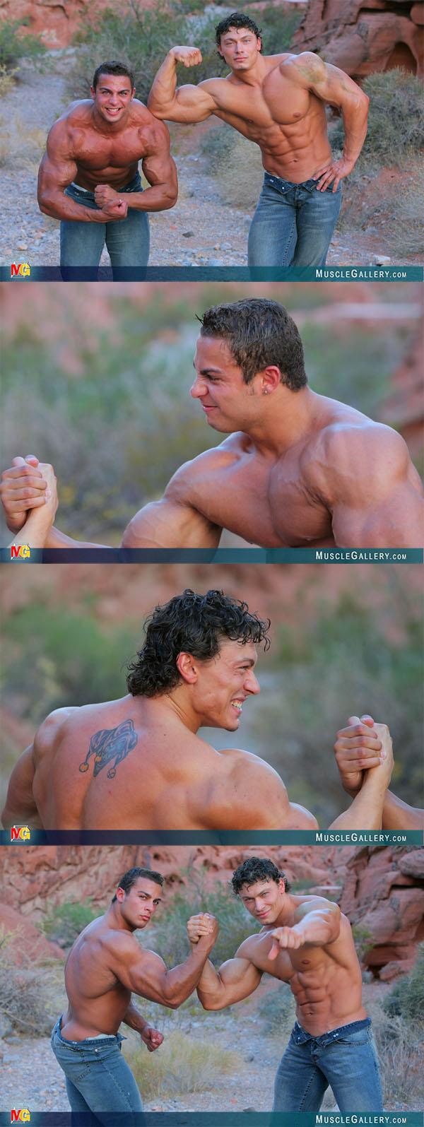 Sweaty bodybuilders arm wrestle