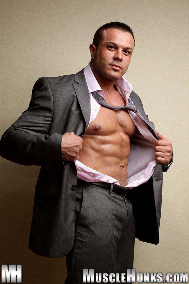 Muscle hunk Joro Welsch stripping out of a suit and tie